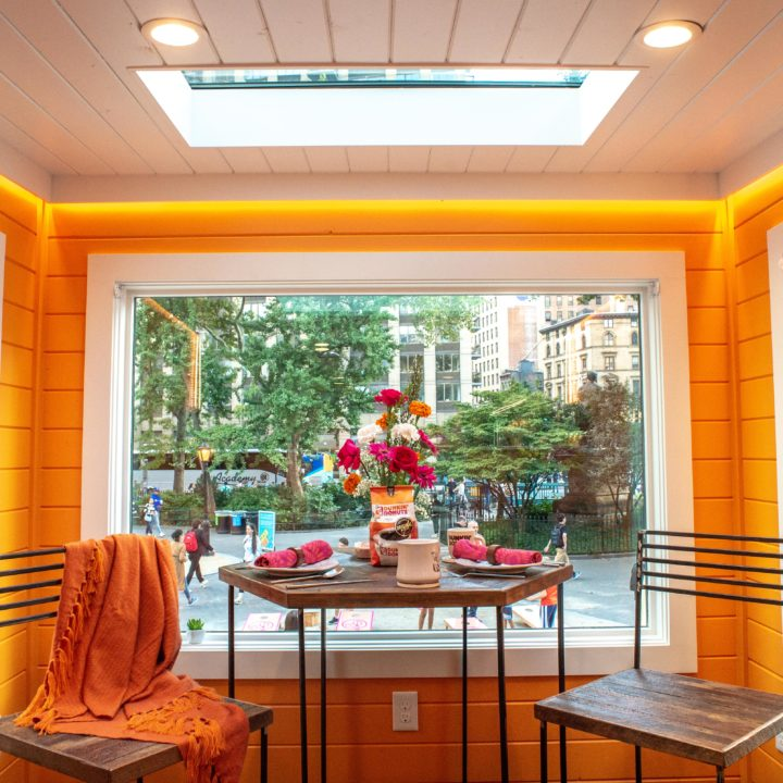 Orange walled dining area in dunkin tiny home