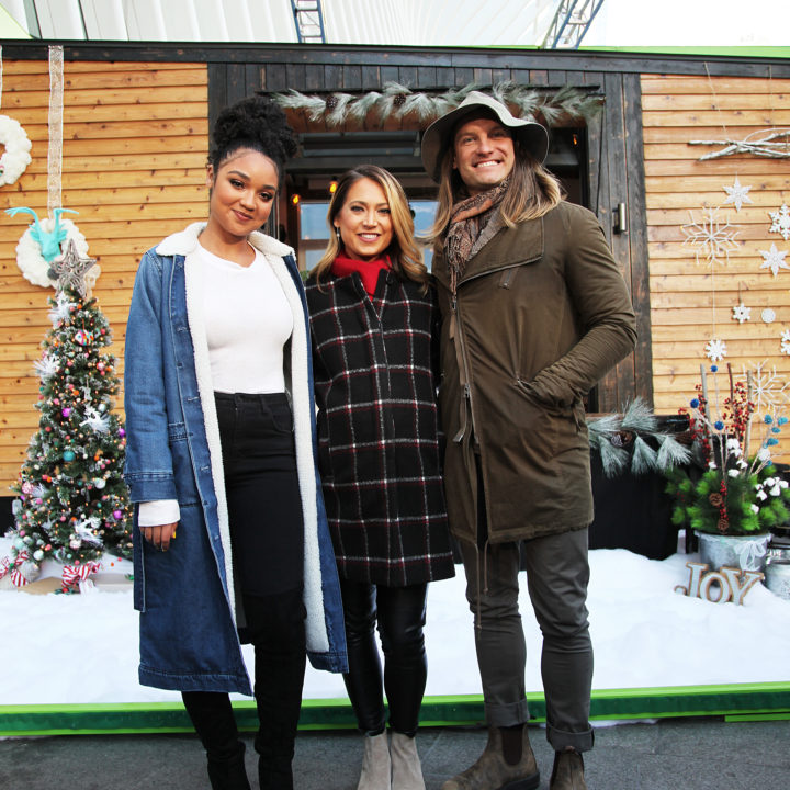 david latimer and two women in winter clothing standing in front of disney tiny home